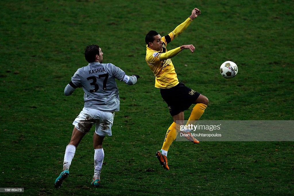 Ahmed Ammi of Venlo and Guram Kashia of Vitesse battle for the ball during the Eredivisie match between VVV Venlo and Vitesse Arnhem at the Seacon Stadion De Koel on December 9, 2012 in Venlo, Netherlands.