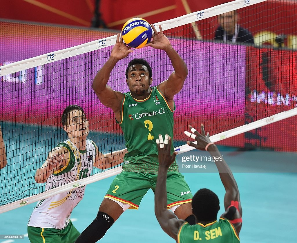 Ahmed Awal Mbutngam of Cameroon setting up during the FIVB World Championships match between Cameroon and Australia on August 31, 2014 in Wroclaw, Poland.