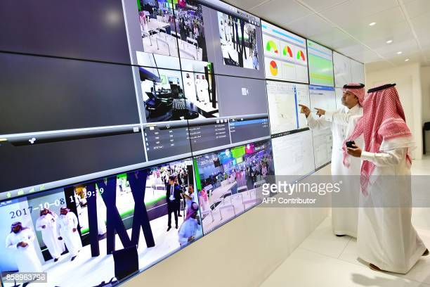 Ahmed Bin Jamil AlMaiman vicepresident of the supervising committee of Saudi Ministry of Interior' inspects security monitors at the Gitex 2017...