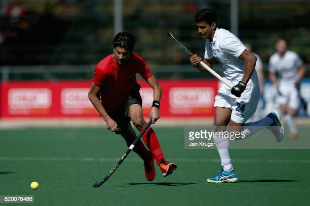 Ahmed Elganaini of Egypt and Arun Panchia of New Zealand battle for possession during the 5th8th place play off match between Egypt and New Zealand...