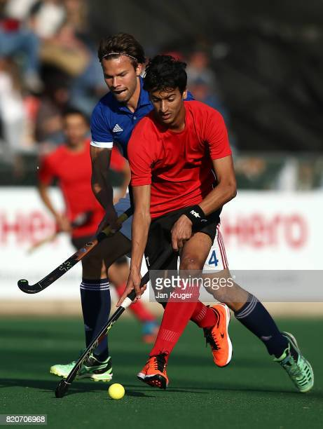 Ahmed Elganaini of Egypt controls the ball from Cristoforo PetersDeutz of France during day 8 of the FIH Hockey World League Men's Semi Finals 5th/...