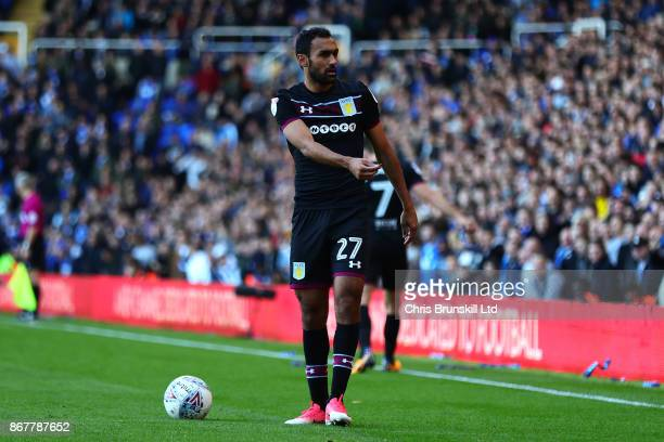 Ahmed Elmohamady of Aston Villa holds a coin that was thrown on the pitch during the Sky Bet Championship match between Birmingham City and Aston...