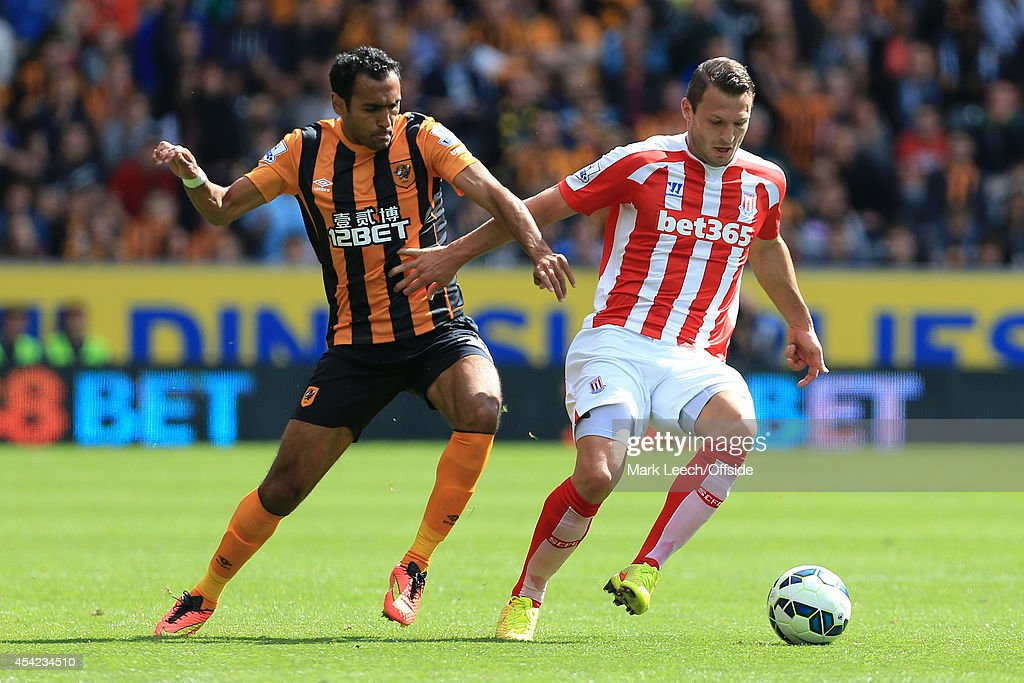 Ahmed Elmohamady of Hull battles with Erik Pieters of Stoke during the Barclays Premier League match between Hull City and Stoke City at the KC Stadium on August 24, 2014 in Hull, England.