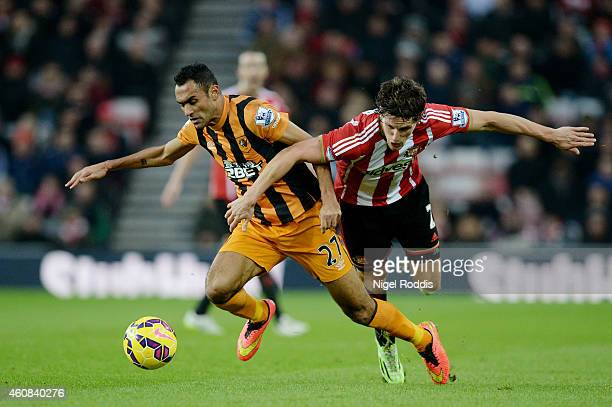 Ahmed Elmohamady of Hull City and Billy Jones of Sunderland battle for the ball during the Barclays Premier League match between Sunderland and Hull...
