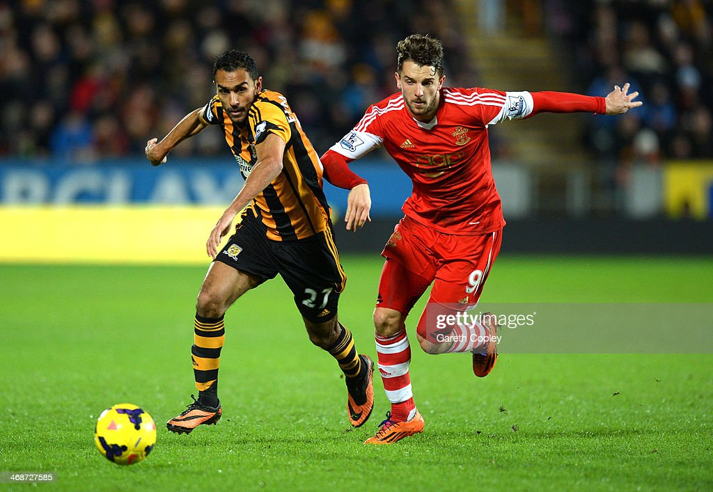 Ahmed Elmohamady of Hull City and Jay Rodriguez of Southampton battle for the ball during the Barclays Premier League match between Hull City and Southampton at the KC Stadium on February 11, 2014 in Hull, England.