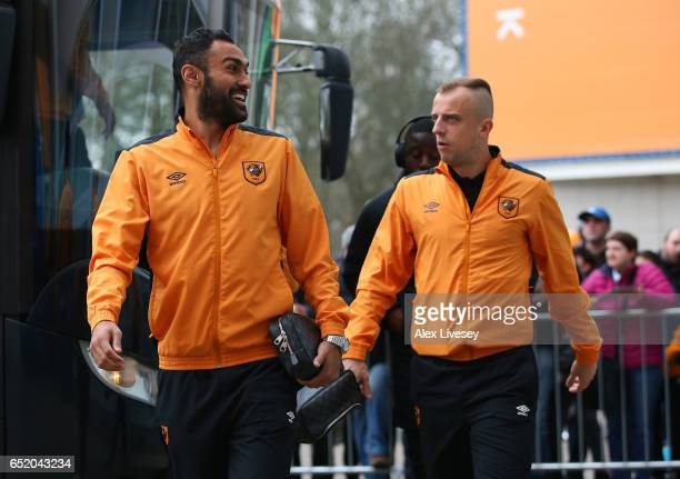 Ahmed Elmohamady of Hull City and Kamil Grosicki of Hull City arrive at the stadium prior to the Premier League match between Hull City and Swansea...