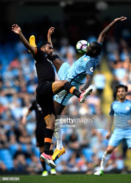 Ahmed Elmohamady of Hull City and Yaya Toure of Manchester City battle for possession during the Premier League match between Manchester City and...