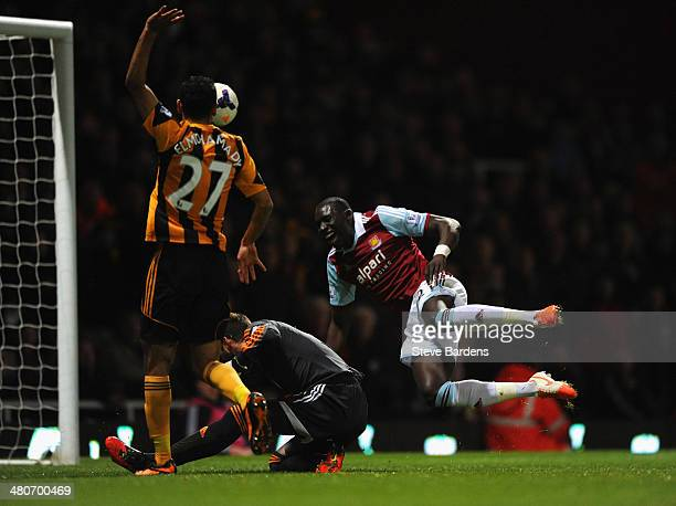 Ahmed Elmohamady of Hull City appeals as Allan McGregor of Hull City brings down Mohamed Diame of West Ham in the area during the Barclays Premier...