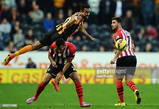 Ahmed Elmohamady of Hull City goes over the top of Ryan Bertrand of Southampton during the Barclays Premier League match between Hull City and...