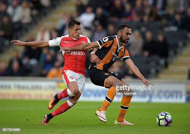 Ahmed Elmohamady of Hull City is tackled by Alexis Sanchez of Arsenal during the Premier League match between Hull City and Arsenal at KCOM Stadium...