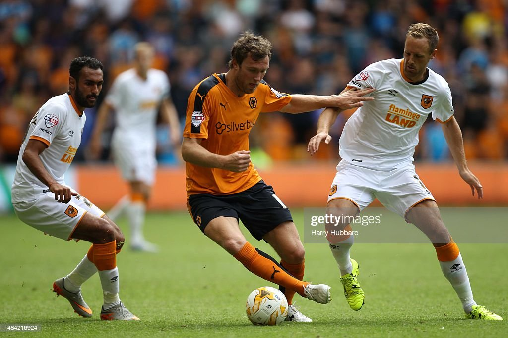 Ahmed Elmohamady of Hull City Kevin McDonald of Wolves and David Meyler of Hull City during the Sky Bet Championship match between Wolverhampton...