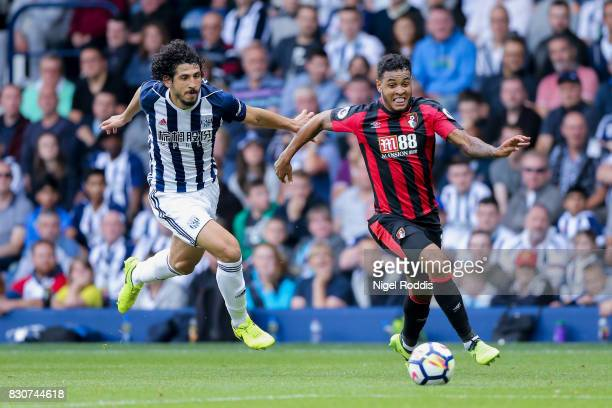 Ahmed ElSayed Hegazi of West Bromwich Albion and Joshua King of AFC Bournemouth battle for possession during the Premier League match between West...