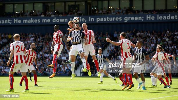 Ahmed ElSayed Hegazi of West Bromwich Albion and Ryan Shawcross of Stoke City battle for possession in the air during the Premier League match...