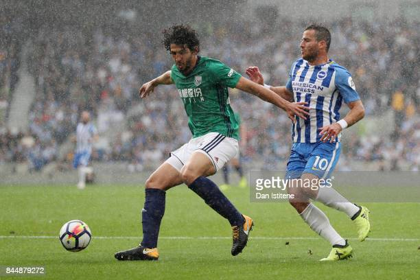 Ahmed ElSayed Hegazi of West Bromwich Albion and Tomer Hemed of Brighton and Hove Albion battle for possession during the Premier League match...