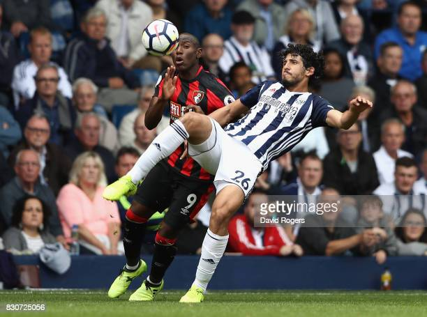 Ahmed ElSayed Hegazi of West Bromwich Albion clears from Benik Afobe of AFC Bournemouth during the Premier League match between West Bromwich Albion...