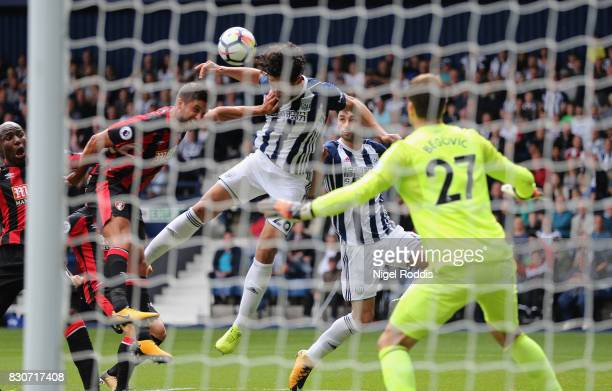 Ahmed ElSayed Hegazi of West Bromwich Albion scores the opening goal past Asmir Begovic of AFC Bournemouth during the Premier League match between...