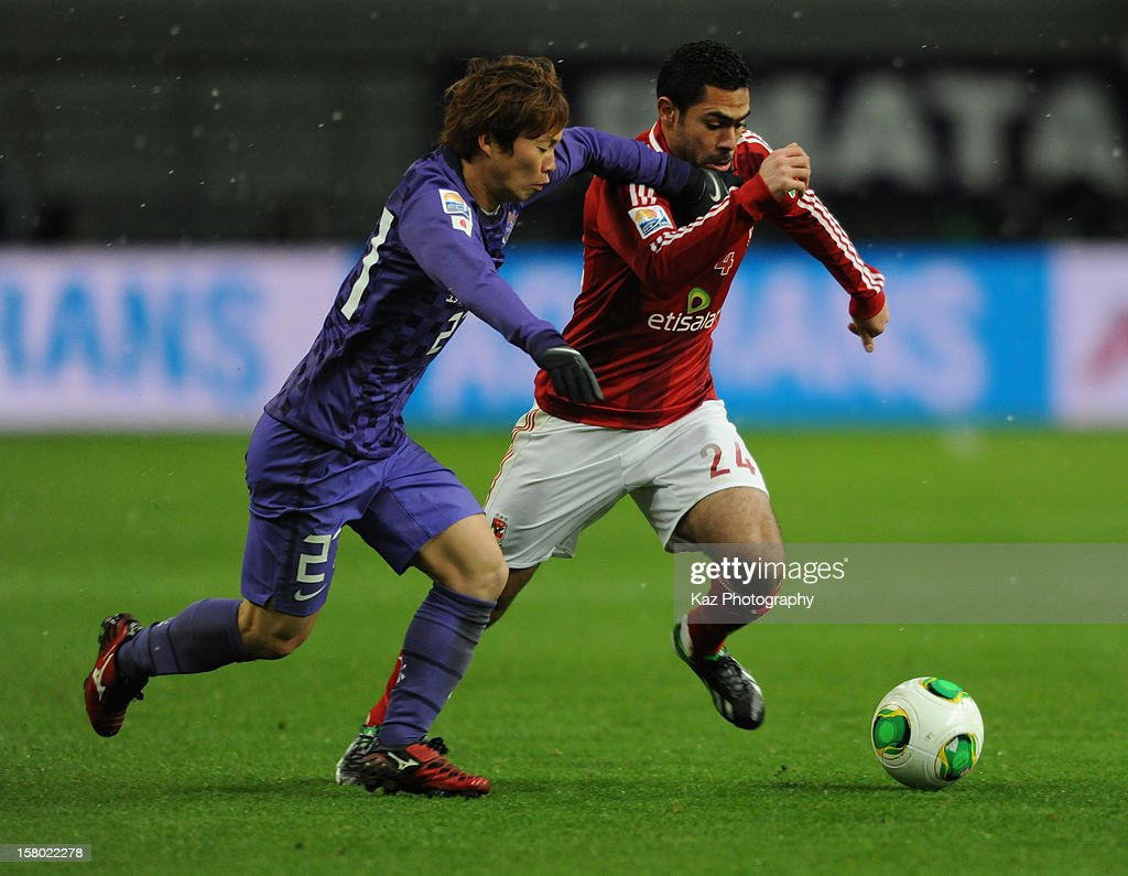 Ahmed Fathi of Al-Ahly SC dribbles the ball under the pressure from Kohei Shimizu of Sanfrecce Hiroshima during the FIFA Club World Cup Quarter Final match between Sanfrecce Hiroshima and Al-Ahly SC at Toyota Stadium on December 9, 2012 in Toyota, Japan.