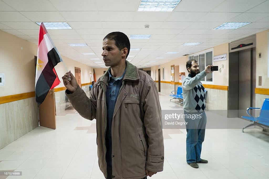 Ahmed Hassan, from Egypt, who says he is a representative from the Muslim brotherhood, stands in the hall of the Shifa Hospital Gaza City, Gaza on November 21, 2012. The hospital received many visiting delegations that roamed the halls showing their support for the Palestinian cause and the new internationalization of the enclave's cause.