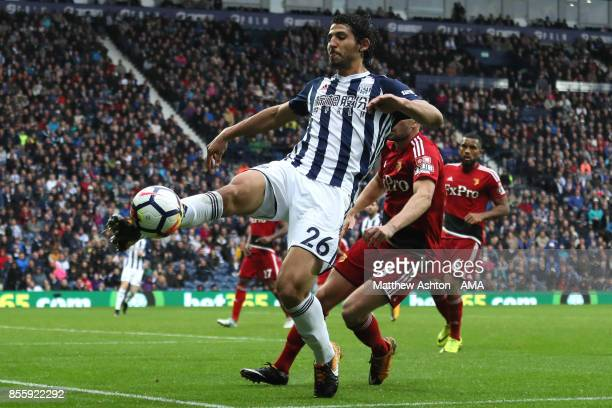 Ahmed Hegazi of West Bromwich Albion competes with Tom Cleverley of Watford during the Premier League match between West Bromwich Albion and Watford...