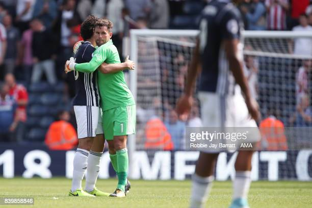 Ahmed Hegazy of West Bromwich Albion and Ben Foster of West Bromwich Albion at full time during the Premier League match between West Bromwich Albion...