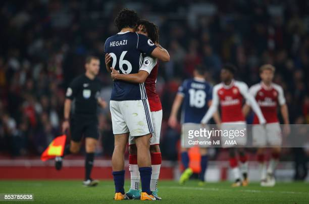 Ahmed Hegazy of West Bromwich Albion and Mohamed Elneny of Arsenal hug after the Premier League match between Arsenal and West Bromwich Albion at...