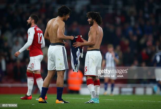 Ahmed Hegazy of West Bromwich Albion and Mohamed Elneny of Arsenal swap shirts after the Premier League match between Arsenal and West Bromwich...