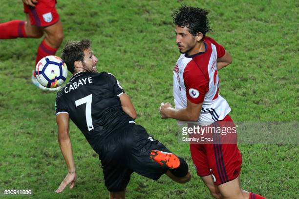 Ahmed Hegazy of West Bromwich Albion clashes with Yohan Cabaye of Crystal Palace during the Premier League Asia Trophy match between West Bromwich...