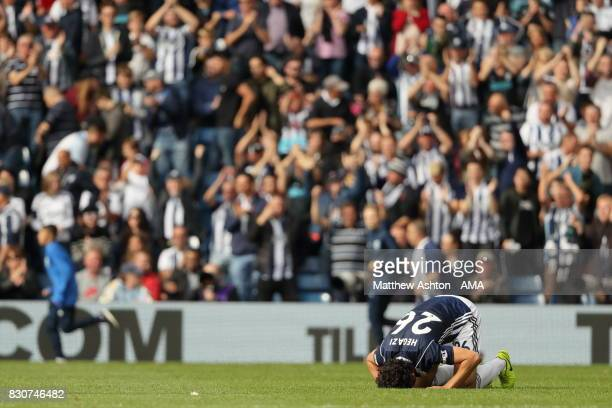 Ahmed Hegazy of West Bromwich Albion preys at the end of the game following him scoring the winning goal during the Premier League match between West...