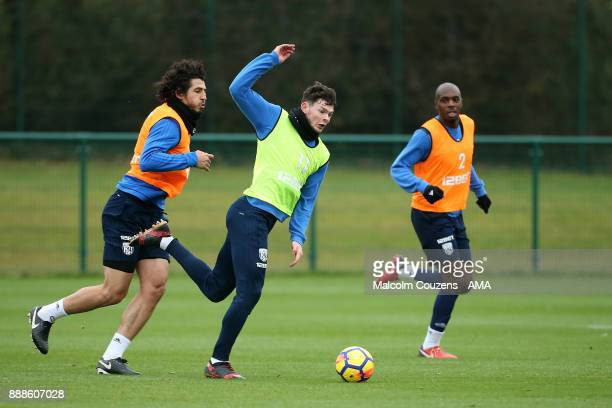 Ahmed Hegazy Oliver Burke and Allan Nyom of West Bromwich Albion during training on December 5 2017 in West Bromwich England