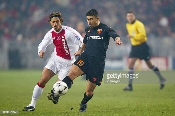 Ahmed Hossam Mido of Ajax Walter Samuel of AS Roma during the Champions League match between Ajax Amsterdam and AS Roma at the Amsterdam Arena on...