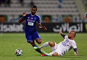 Ahmed Ibrahim Alyassi of Al Nasr is tackled by Miroslav Stoch of Al Ain during the Presidents Cup Quarter Final match between Al Ain and Al Nasr at...