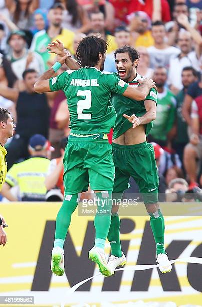 Ahmed Ibrahim of Iraq and Saad Abdulameer celebrate a goal by Younus Mahmood during the 2015 Asian Cup match between Iran and Iraq at Canberra...