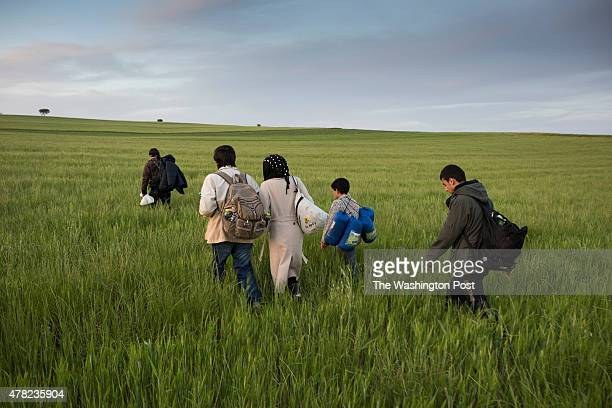 'THE BLACK ROUTE' Ahmed Jinaid and his family on the Greek/Macedonian border on May 5th 2015 in Evzoni Greece With the sun setting rapidly Ahmed...