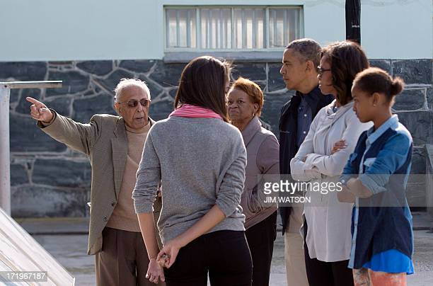 Ahmed Kathrada a former prisoner with antiapartheid activist Nelson Mandela tours US President Barack Obama and his family through Robben Island...
