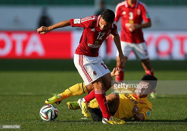 Ahmed Kenawi of AlAhly SC holds off a challenge from Lin Gao during the FIFA Club World Cup Quarter Final match between Guangzhou Evergrande FC and...