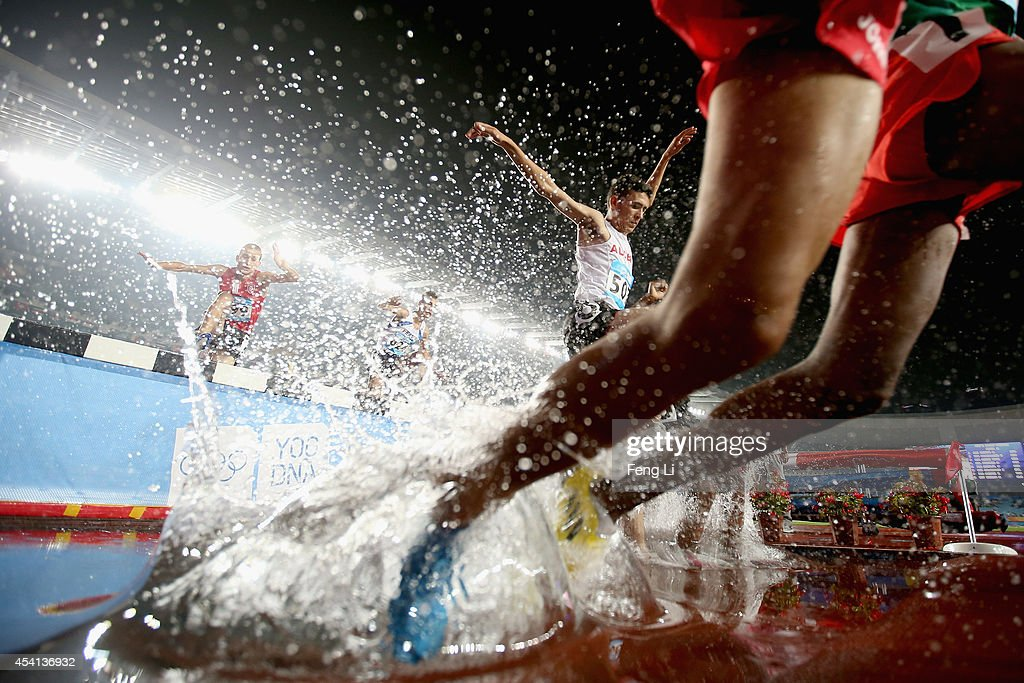 Ahmed Kenzi Saidia of Algeria (Center) competes in Men's 2000m Steeplechase Final of Nanjing 2014 Summer Youth Olympic Games at the Nanjing Olympic Sports Centre on August 25, 2014 in Nanjing, China.