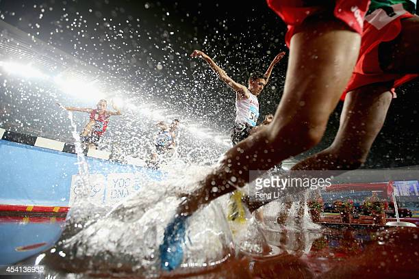 Ahmed Kenzi Saidia of Algeria competes in Men's 2000m Steeplechase Final of Nanjing 2014 Summer Youth Olympic Games at the Nanjing Olympic Sports...