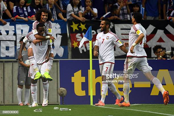 Ahmed Khalil and Omar Abdulrahman of United Arab Emirates celebrate the second goal during the 2018 FIFA World Cup Qualifiers Group B match between...