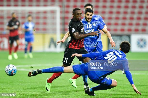 Ahmed Khalil of UAE's AlAhli FC fights for the ball against Leandro Padovani of Iran's Esteghlal FC during their AFC Champions League qualifying...