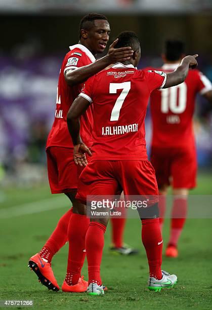 Ahmed Khalil Sebait Mubark Alkunaibi of Al Ahli is congratulated by team mate Ismail Salem Ismail Saeed Al Hammadi after scoring the first goal...