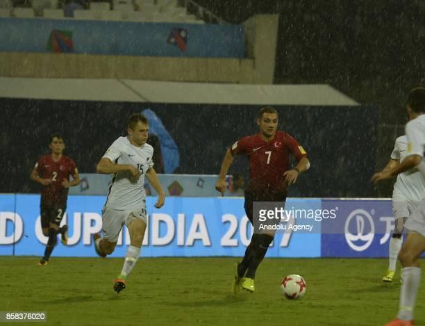 Ahmed Kutucu of Turkey U17 in action against Ben Alexander Deeley of New Zealand U17 during the FIFA U17 World Cup India 2017 football match between...