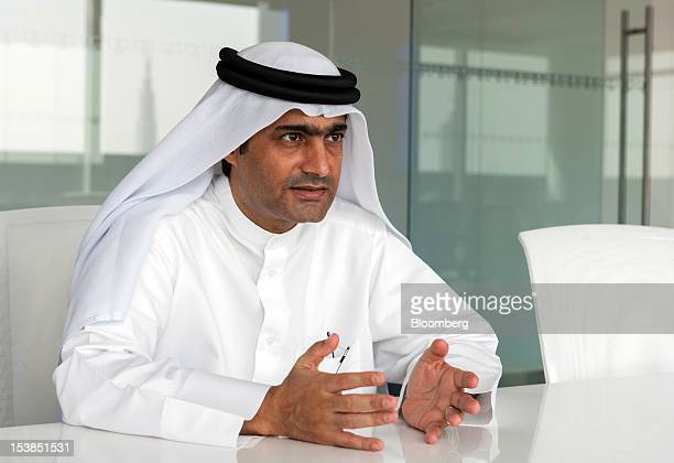 Ahmed Mansoor a Dubaibased blogger and activist gestures as he poses for a photograph in Dubai United Arab Emirates on Tuesday Sept 25 2012 The...