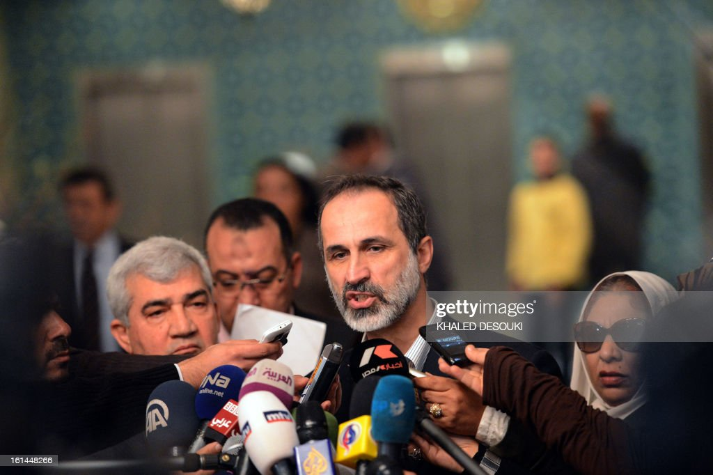 Ahmed Moaz al-Khatib, President of the National Coalition for Syrian Revolutionary and Opposition Forces, talks to the press following his meeting with Arab League Secretary General Nabil al-Arabi (not seen) in the League headquarters in Cairo on February 11, 2013.