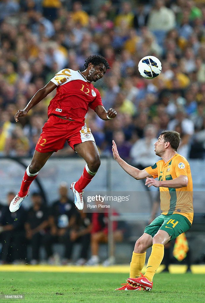 Ahmed Mubarak of Oman competes for the ball against <a gi-track='captionPersonalityLinkClicked' href=/galleries/search?phrase=Brett+Holman&family=editorial&specificpeople=2224226 ng-click='$event.stopPropagation()'>Brett Holman</a> of the Socceroos during the FIFA 2014 World Cup Qualifier match between the Australian Socceroos and Oman at ANZ Stadium on March 26, 2013 in Sydney, Australia.