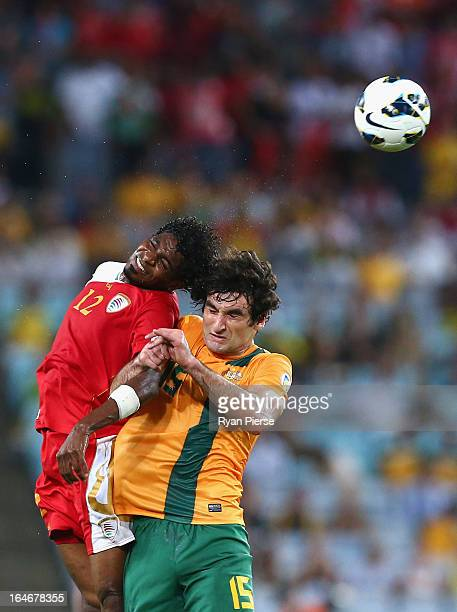 Ahmed Mubarak of Oman competes for the ball against Mile Jedinak of the Socceroos during the FIFA 2014 World Cup Qualifier match between the...