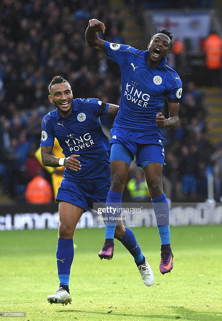 Ahmed Musa of Leicester City (R) celebrates scoring his sides first goal with his team mate Danny Simpson of Leicester City (L) during the Premier League match between Leicester City and Crystal Palace at The King Power Stadium on October 22, 2016 in Leicester, England.