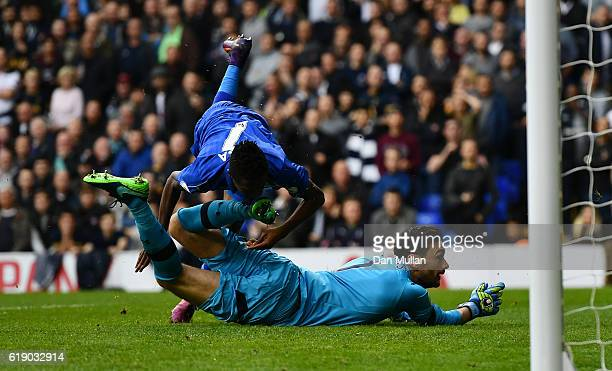 Ahmed Musa of Leicester City collides with Hugo Lloris of Tottenham Hotspur after scoring his side's first goal during the Premier League match...