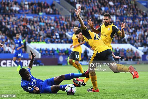 Ahmed Musa of Leicester City is challenged by Hector Bellerin of Arsenal during the Premier League match between Leicester City and Arsenal at The...
