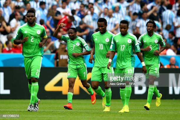 Ahmed Musa of Nigeria celebates scoring his team's first goal with his teammates during the 2014 FIFA World Cup Brazil Group F match between Nigeria...