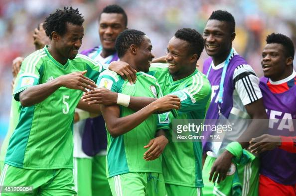 Ahmed Musa of Nigeria celebrates his team's second goal with his teammates during the 2014 FIFA World Cup Brazil Group F match between Nigeria and...